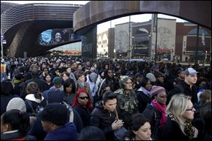 Commuters wait in a line to board buses into Manhattan in front of the Barclays Center in Brooklyn, New York. The line stretched twice around the arena and commuters reported wait times of one to three hours to get on a bus.