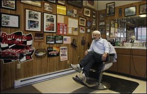 Barbershop owner Dave Martin, who as a child saw George Romney speak, is supporting Mitt Romney for the presidency.