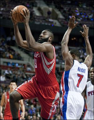Houston Rockets guard James Harden goes to the basket past Pistons guard Brandon Knight during the first half Wednesday in Detroit.