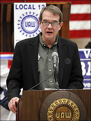 Bob King, president of the United Auto Workers union, speaks at the UAW Local 12 hall in Toledo. He says the public deserves to know how much Mitt Romney bet against American workers with his investments.