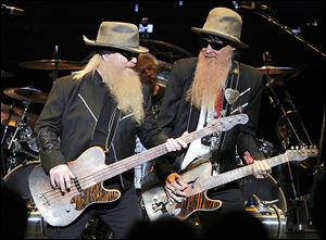 Dusty Hill, left, Frank Beard, on drums, and Billy F Gibbons performed Thursday at the Stranahan Theater.