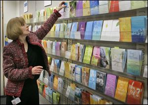 A woman looks over a selection of greeting cards at Hallmark Cards Inc. headquarters in Kansas City, Mo.