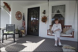 Obama supporter Corinne Hurni sits on her Hicksville, Ohio, porch on east Smith Street.