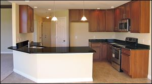 The gourmet kitchen features lots of granite-topped counter space.