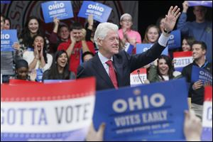 Former President Bill Clinton  stumps for the Obama-Biden ticket at an appearance at Owens Community College.
