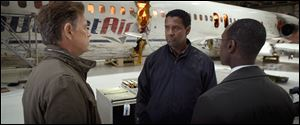 from left, Bruce Greenwood as Charlie Anderson, Denzel Washington as Whip Whitaker and Don Cheadle as Hugh Lang in a scene from