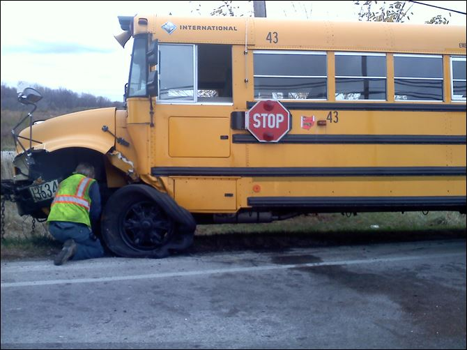 Bus 43 Bus No. 43 sits along the side of the road after a crash early today.