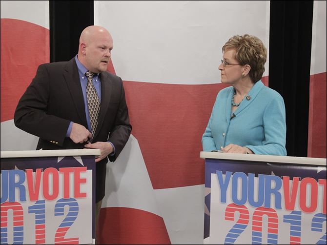 CTY debate27p wurzelbacher, kaptur chat Republican challenger Samuel Wurzelbacher and Rep. Marcy Kaptur (D., Toledo) talk after a recent debate.
