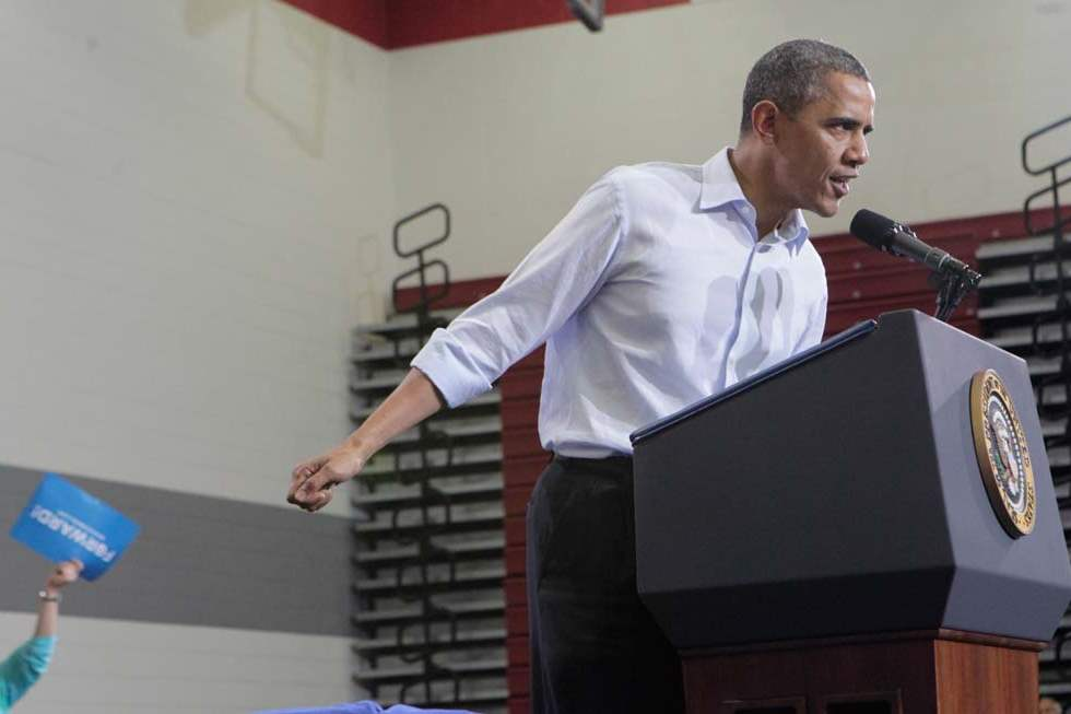 President-Barack-Obama-speaking-to-a-packed-gym-1