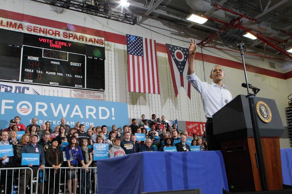 President-Barack-Obama-speaking-to-a-packed-gym