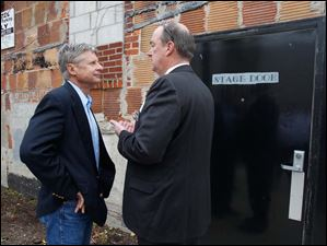 Libertarian presidential candidate Gary Johnson, left, confers with Kevin Knedler, chairman of the state Libertarian Party, before Johnson speaks at the Clazel Theater in Bowling Green, Ohio.