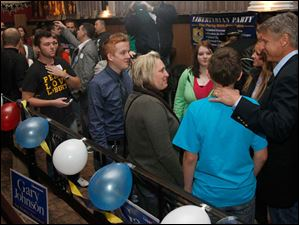 Pemberville resident Zach Featherston, 13, front left, meets Libertarian presidential candidate Gary Johnson, right, after Johnson's speech at the Clazel Theater in Bowling Green, Ohio.