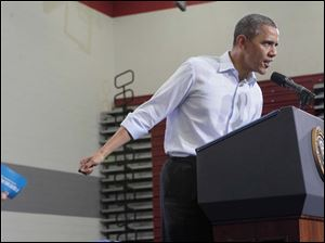 President Barack Obama speaking to a packed gym at Lima Senior High School.