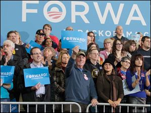 Supporters wave signs in support of President Barack Obama at Lima Senior High School in Lima, Ohio.