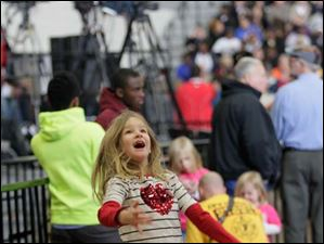 Nataley Hattery, 8, of Van Wert, entertans herself while waiting for the president.