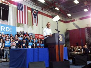 President Barack Obama addresses the crowd during a campaign stop at a high school in Lima, Ohio.
