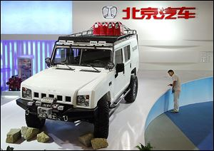 A Jeep made by Beijing Automotive Industry Corp. is on exhibit in Beijing in 2009. Chrysler's joint venture with China began in 1985 but ended with the automaker's bankruptcy in 2009.