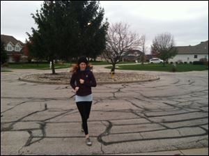 Reporter Kelly McLendon jogs through Sylvania.