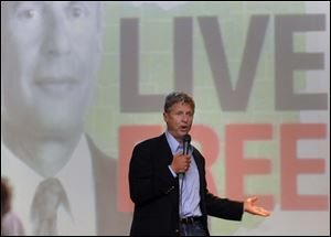 Libertarian presidential candidate Gary Johnson tells the crowd in Bowling Green that voting for him would rain on the two-party system. He spoke there downtown Friday.