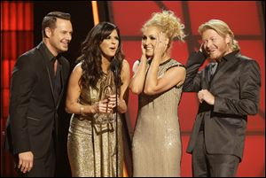 Musical group Little Big Town, from left, Jimi Westbrook, Karen Fairchild, Kimberly Schlapman and Phillip Sweet, accept the award for single of the year for