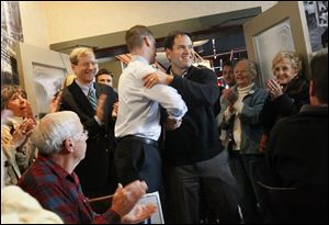 Republican U.S. Sen. Marco Rubio, center right, embraces Republican U.S. Senate candidate Josh Mandel before speaking to a packed room of supporters.