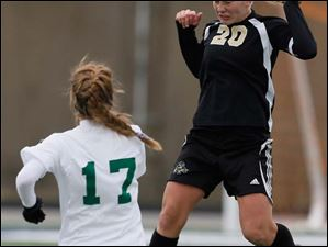 Perrysburg's Mollie Whitacre (20) moves the ball.
