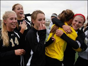 Perrysburg's Abby Sattler (14) Allex Brown (18), Lucy Walton (4), Chloe Buehler, and Mollie Whitacre (20) celebrate after defeating Medina.