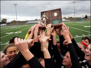 Perrysburg hoists its first regional championship trophy.