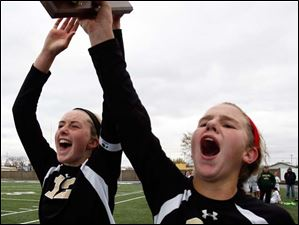 Perrysburg's Maddy Williams (12) and  Mollie Whitacre (20) celebrate.