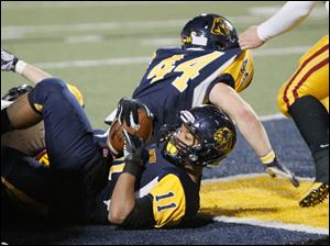 Whitmer's Me'Gail Frisch, 11, lands backwards into the end zone.