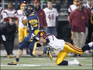 Whitmer's Nathan Holley, 18, is tackled by Avon Lake's Max Seipel after an 18-yard gain.