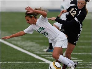 Perrysburg's Maddy Williams (12) knocks over  Medina's Olivia Sency.