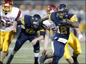 Whitmer's Tre Sterritt looks for running room.