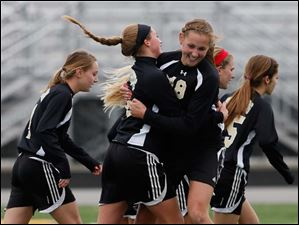 Perrysburg's Allex Brown (18) celebrates scoring a goal against Medina.