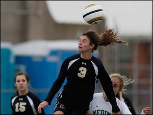Perrysburg's Courtney Clody (3) moves the ball against Medina's Brianna Caccavale (25).