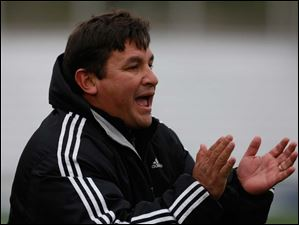 Perrysburg co-head coach Jorge Diaz shouts instructions.