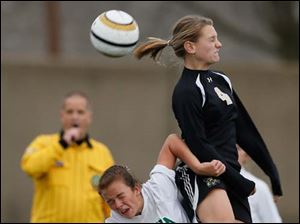Perrysburg's Lucy Walton (4) moves the ball.