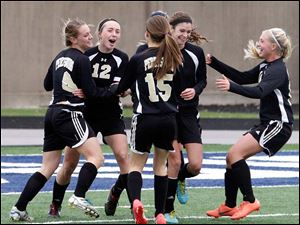 Perrysburg's Lucy Walton (4) and Maddy Williams (12) celebrate their score against Medina.