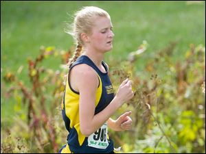 Toledo Christian High School runner Delaney Phelps placed fourth in Div. III.