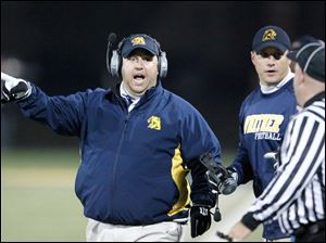 Whitmer head coach Jerry Bell argues a call during the first quarter.