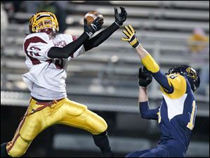 Avon Lake's Jace Russell breaks up a pass intended for Whitmer's Nathan Holley in the end zone.
