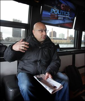 CNN's Ali Velshi on the CNN Election Express bus 2012.  The CNN Election Express bus is traveling to 4 swing states to interview voters, including Toledo, where it was parked Friday along the Maumee River in International Park.
