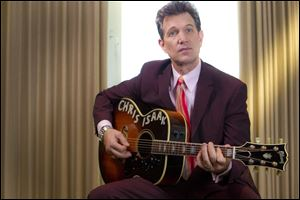 """You can't help but feel the history in that room,"" Chris Isaak says of recording in the historic Sun Studio."
