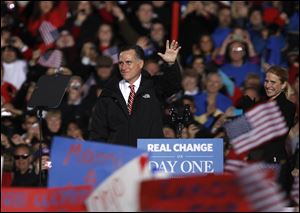 Mitt Romney acknowledges the crowd in West Chester, Ohio. An estimated 30,000 people turned out Friday in the home county of House Speaker John Boehner.