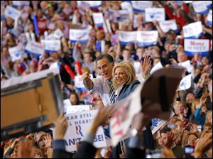 Presidential candidate and former Massachusetts governor Mitt Romney with his wife, Ann, greet the crowds during a campaign rally at the I-X Center in Cleveland.