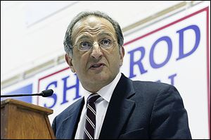 James Zogby, founder and president of the Arab-American Institute, speaks during the annual Chicken Paprikas Dinner at St. Stephen's Hall  on Sunday.