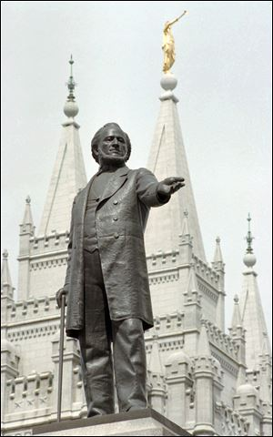Mitt Romney can trace ancestors back to associates of Brigham Young,  subject of a statue at the temple in Salt Lake City.