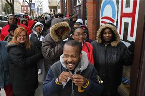 Obama supporters turned out in force to obtain tickets for the President's recent Lima appearance. Gregory Pitts of Lima, center, was the first person to receive a ticket to hear the President speak.