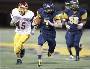 Whitmer quarterback Nick Holley, 7, outraces the Avon Lake High School defense for a touchdown in the fourth quarter.