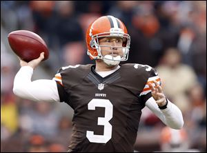 Cleveland Browns quarterback Brandon Weeden passes against the Baltimore Ravens in the fourth quarter.